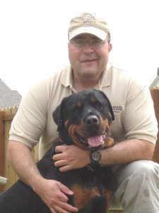 Troy and one of his rottweilers, Bradum
